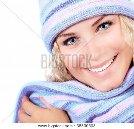 Happy girl in winter hat, beautiful young female wearing knitted warm wintertime clothing