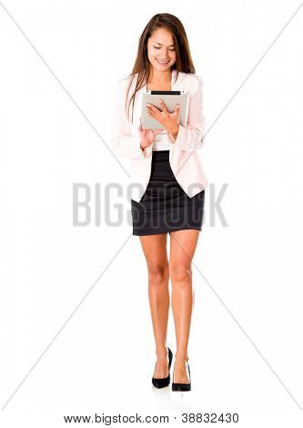 Businesswoman working on a tablet computer - isolated over white