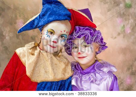 Portrait of two adorable little girls in clown disguise