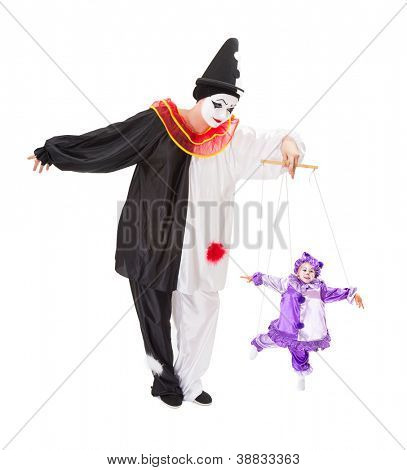 Pierrot playing with a living clown as a marionette puppet on strings