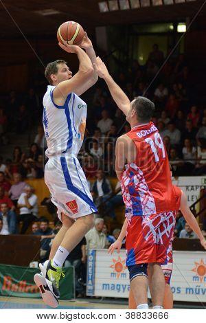 KAPOSVAR, HUNGARY - OCTOBER 20: Marco Spica (in white) in action at Hungarian Championship basketball game with Kaposvar (white) vs. Nyiregyhaza (red) on October 20, 2012 in Kaposvar, Hungary.