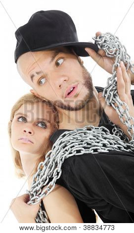 Rapper and graceful girl hold metal chain isolated on white background.