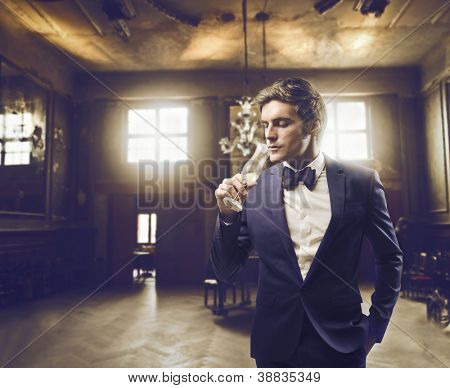 Man sipping champagne in an elegant setting