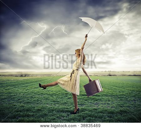 Woman, in a large grace field, is taken away by a gust