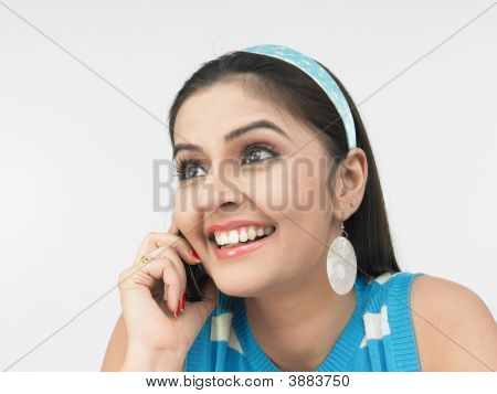 Beautiful Young Asian Girl Talking On Her Cell Phone