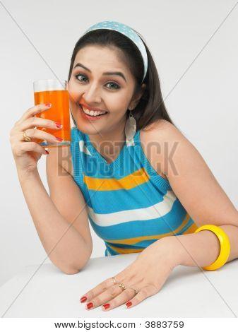 Beautiful Young Asain Woman Drinking Orange Juice