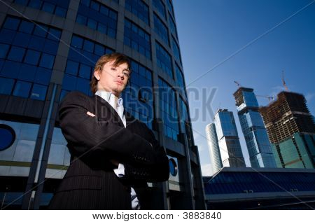 Portrait Of Young Quiet Businessman By Skyscrape