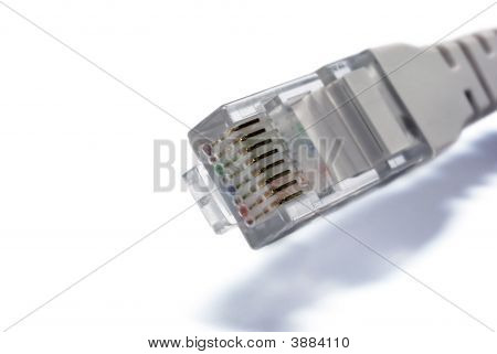 Rj45 Connector Of Utp Cable Closeup On White Background
