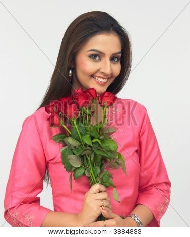 Lady With A Bouquet Of Red Roses