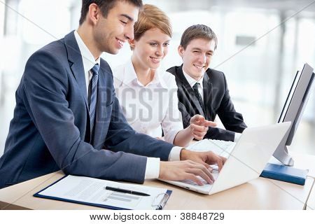 Portrait of a group of business people working together at a meeting