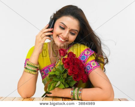 Young Asian Woman Of Indian Origin With A Bouquet Of Roses
