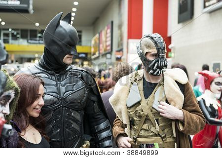 LONDON, UK - OCTOBER 28: Batman and Bane posing at the London Comicon MCM Expo. Most participants dress up as superheroes to compete in the Euro Cosplay Championship. October 28, 2012 in London.
