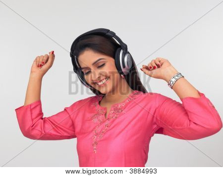 Woman Grooving To The Music