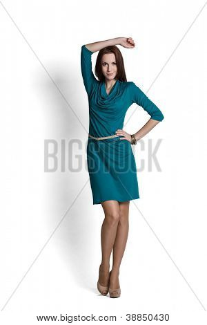 Fashion model wearing green dress with emotions