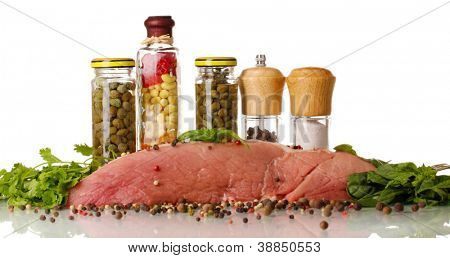 A large piece of pork marinated with herbs, spices and cooking oil isolated on white