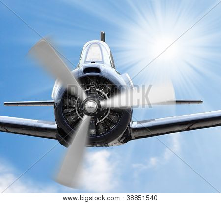 Vintage plane on a sunny sky. Retro technology background.