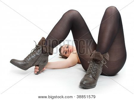 Beautiful woman in black nylons showing her new boots.