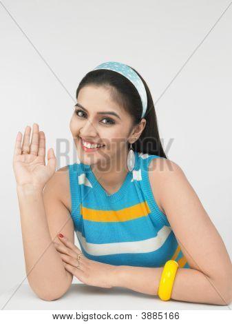 Asian Woman Waving Her Hand