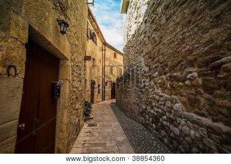 Narow street in Besalu, Spain