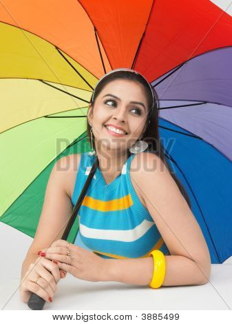 Asian Woman With A Rainbow Umbrella