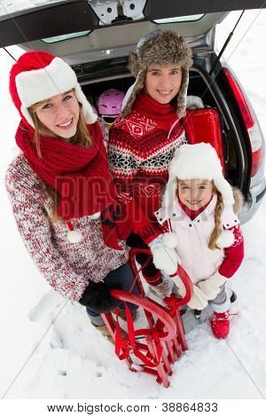 Winter holidays, ski, travel - family with baggage ready for the travel for winter holidays