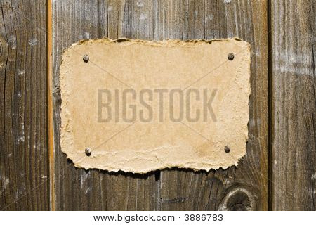 Torn Cardboard On Wooden Wall