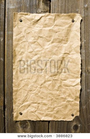 Old Paper On Dark Wooden Texture
