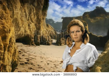 Young Female Model On Rocky Beach