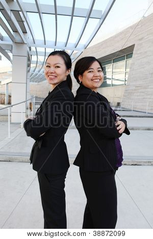An attractive ethnic business women team at office building