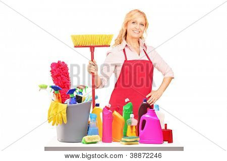 A female cleaner posing with cleaning equipment isolated against white background