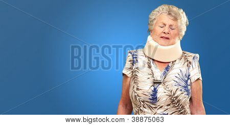 A Senior Woman Wearing A Neck brace On Blue Background