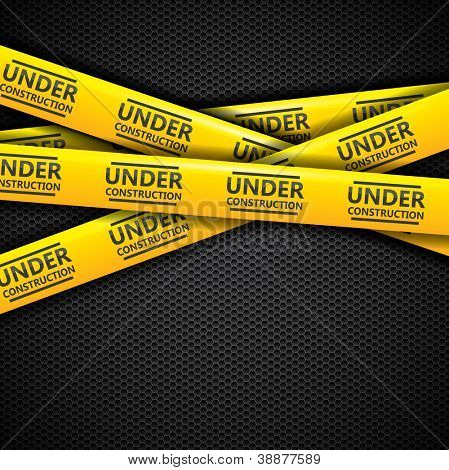 Under construction caution tape on metallic pattern background