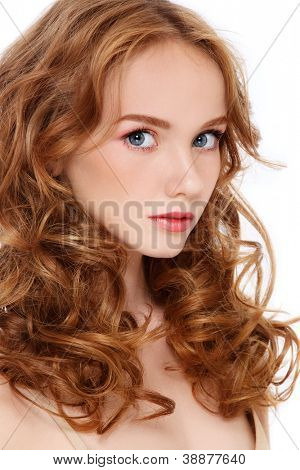 Portrait of young beautiful teen girl with curly red hair on white background