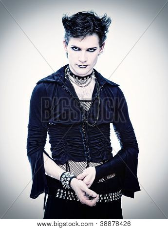 goth-style man in black dress photo