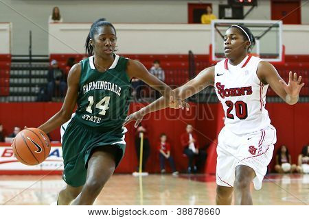NEW YORK-NOV 3: Farmingdale Rams guard Siohban Purvis dribbles past St. John's Red Storm guard Keylantra Langley (20) at Carnesecca Arena on November 3, 2012 in Jamaica, Queens, New York.