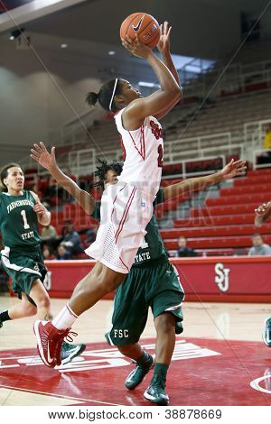 NEW YORK-NOV 3: St. John's Red Storm guard Keylantra Langley (20) shoots over the Farmingdale Rams at Carnesecca Arena on November 3, 2012 in Jamaica, Queens, New York.