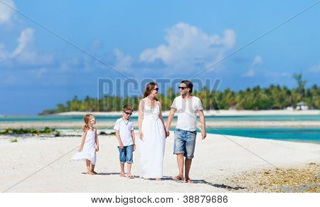 Beautiful Caucasian family at tropical beach