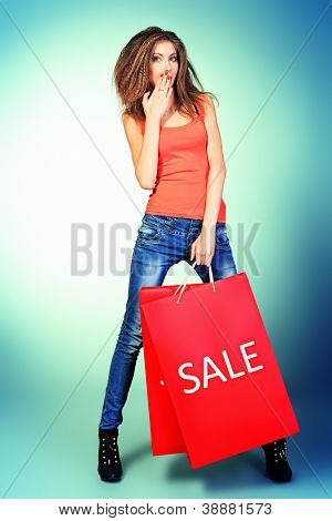 Full length portrait of a pretty girl with shopping bags.