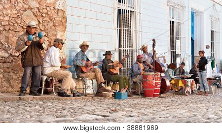 TRINIDAD, CUBA -JAN. 12:Traditional musicians playing in the streets of Trinidad on January 12, 2010 in Trinidad. Trinidad was declared by UNESCO World Heritage Site in 1988.