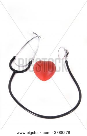Conceptual Stethoscope On Heart Isolated In White
