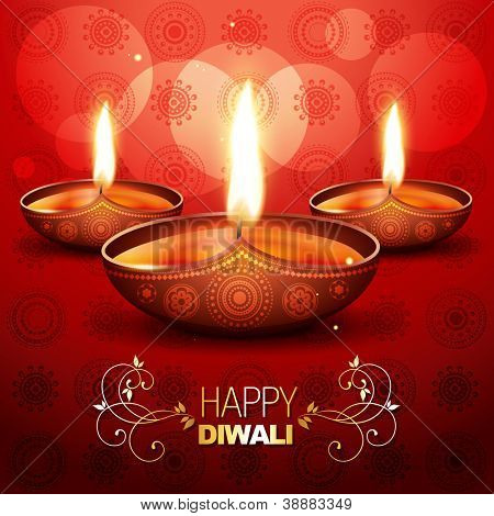 beautiful shiny diwali diya placed on artistic red background
