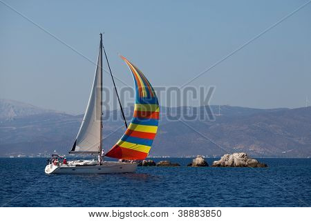 "SARONIC GULF, GREECE - SEPTEMBER 24: Competitors boats during of sailing regatta ""Viva Greece 2012"" on September 24, 2012 on Saronic Gulf, Greece."