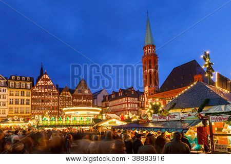 FRANKFURT -  DECEMBER 18 2011: People visit traditional christmas market in Frankfurt, Germany on December 18, 2011. The very first Christmas market was held in Frankfurt in 1393.