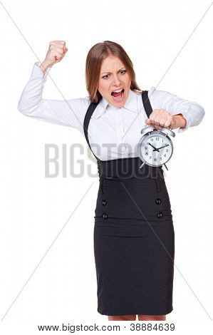 discontented businesswoman holding the alarm clock. isolated on white background
