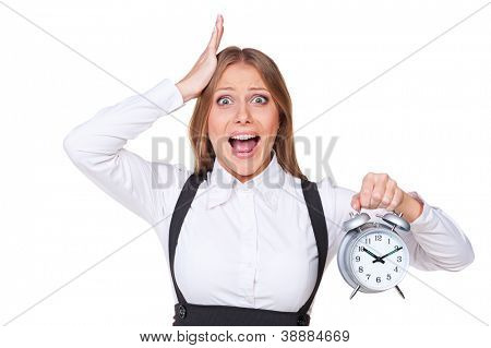 screaming and shocked businesswoman holding alarm clock. isolated on white background