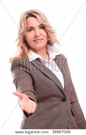 Portrait of 40 years old woman in office suit giving you a handshake isolated on a white