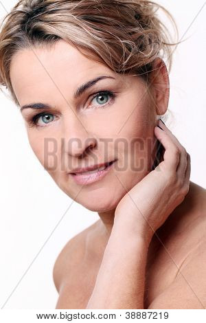 Portrait of beautiful mid aged woman isolated on a white