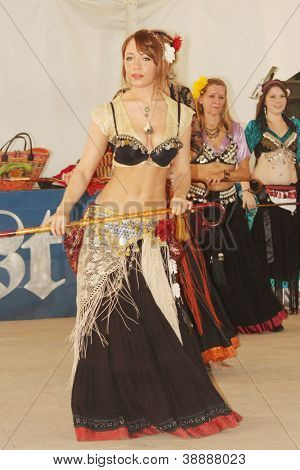 TULSA, OK - OCT 20: Members of Gypsy Fire Belly Dancers group perform at Oktoberfest in TULSA, OK, on October 20, 2012 in TULSA, OK.