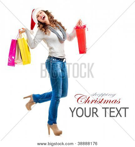 Santa Fashion Girl with Shopping Bags. Christmas Shopping. Sales. Full Length Portrait