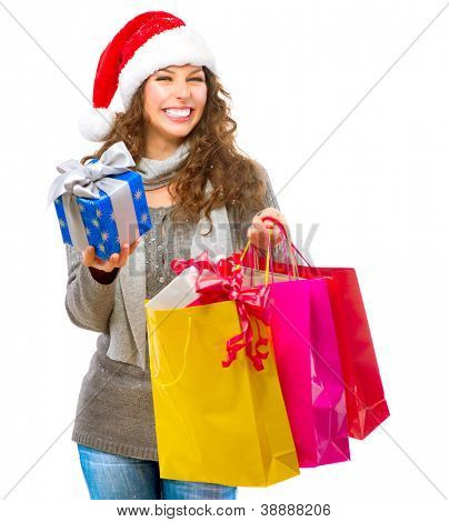 Christmas Gift. Happy Fashion Woman with Shopping Bags. Sales. Christmas Gifts. Christmas Shopping. Isolated on White Background